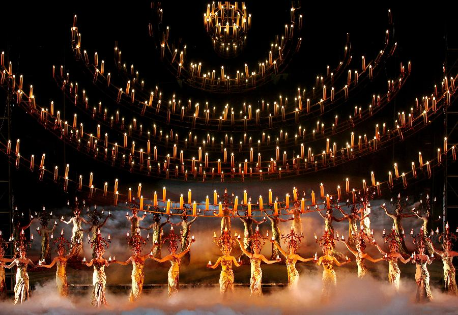 Dancers show a performace that combines magic and dance in Qingdao, east China's Shandong Province, Sept. 8, 2012. With elements of magic, music, dance and visual effects, the performance attracted many visitors in Qindao on Saturday. (Xinhua)