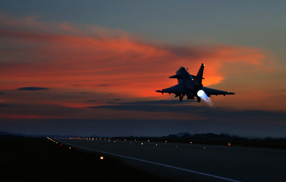 A photo released by Xinhua News Agency on Sept.12 shows a new generation fighters of the Chinese People's Liberation Army Air Force in China's Yunnan taking off at night to carry out emergent training, in a bid to improve the troops' emergent combat effectiveness. (Photo/Xinhua)