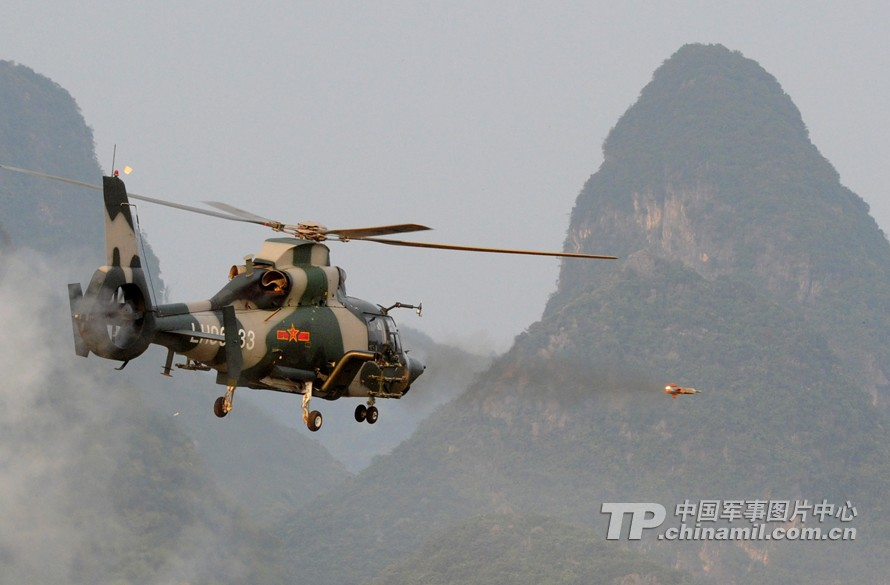 An armed helicopter is conducting extreme-low-altitude precise assault to the target. (China Military Online/Wu Sulin)