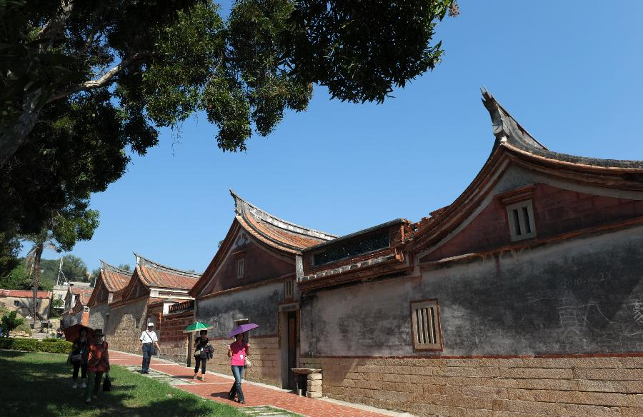 Tourists visit the ancient houses at Shanhou Village in Kinmen, southeast China's Taiwan, Sept. 17, 2012. Over 500 ancient houses, which dated back to hundreds of years, now still could be seen in Kinmen, with construction styles similar to those in south Fujian Province across the Taiwan Strait. A total of 61 ancient houses have been refitted into guest houses, attracting many tourists every year.(Xinhua/Yin Bogu)