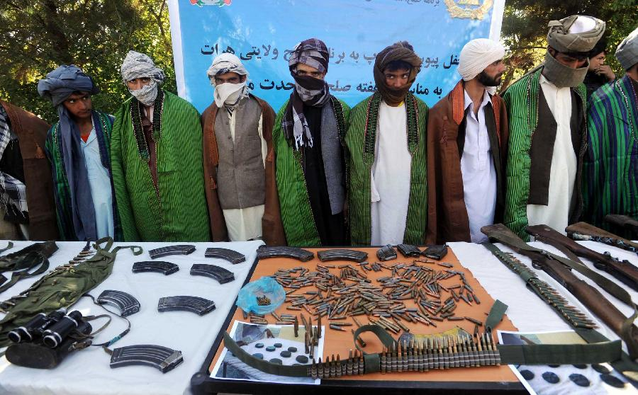 Taliban fighters attend a surrender ceremony in Kunduz province, north Afghanistan, Sept. 18, 2012. Eleven Taliban fighters laid down arms and joined the government-backed peace process on Monday in Kunduz province, 250 km north of Kabul. (Xinhua/Sardar)