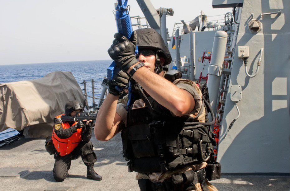 Chinese and U.S. navies conduct their first joint anti-piracy drill in the Gulf of Aden.