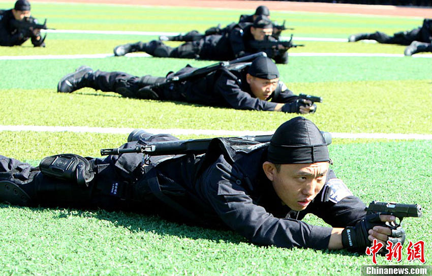 On September 24, 2012, public security system of Jilin province held its first police sports games in Changchun City. 670 contestants of 16 teams participated in the fierce competition of 20 projects in three categories. On the day of the opening ceremony, armed police, special police and police cadets gave wonderful performances of gun operation, fighting and tactical action. Picture shows special police performing shooting in the prone position. (CNS/Zhang Yao)