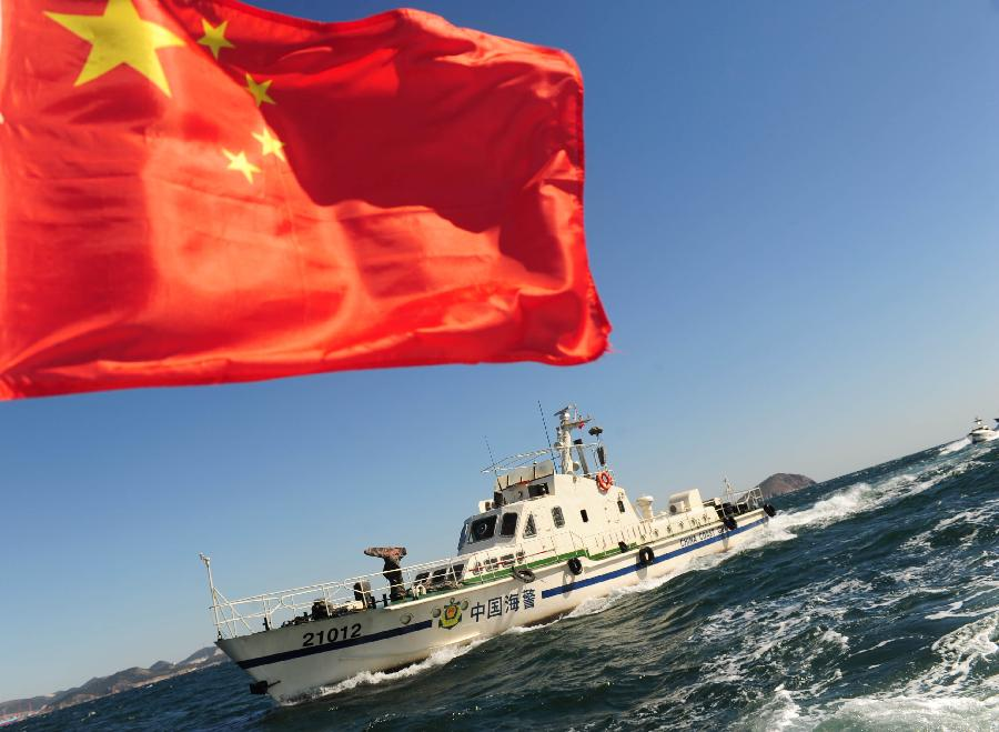 China Coast Guard vessels patrol in the sea of Dalian, northeast China's Liaoning Province, Oct.10, 2012. The Liaoning Coast Guard has intensified patrol in the Huanghai and Bohai seas to guarantee the safety and maritime order during the autumn fishing period. (Xinhua/Jiang Bing)