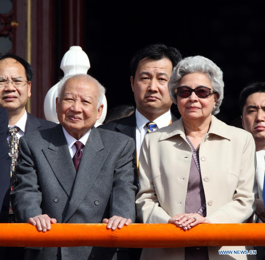 File photo taken on Oct. 1, 2009 shows Norodom Sihanouk (L Front) and his wife Monineath (R Front) watch the celebrations for the 60th anniversary of the founding of the People's Republic of China, on the Tian'anmen Rostrum in central Beijing, capital of China. Cambodian King-Father Norodom Sihanouk died due to illness at the age of 90 early Monday morning in Beijing. (Xinhua/Yao Dawei)