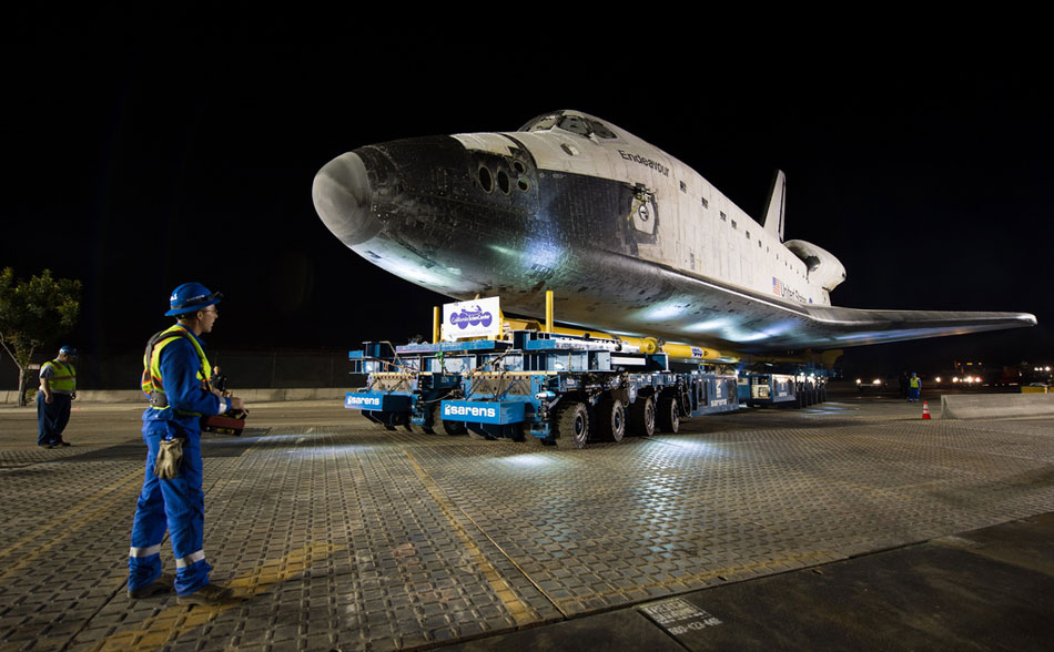 The space shuttle Endeavour moves out of the Los Angeles International Airport and onto the streets of Los Angeles heading for its new home at the California Science Center, Oct. 12, 2012. (Photo/NASA)