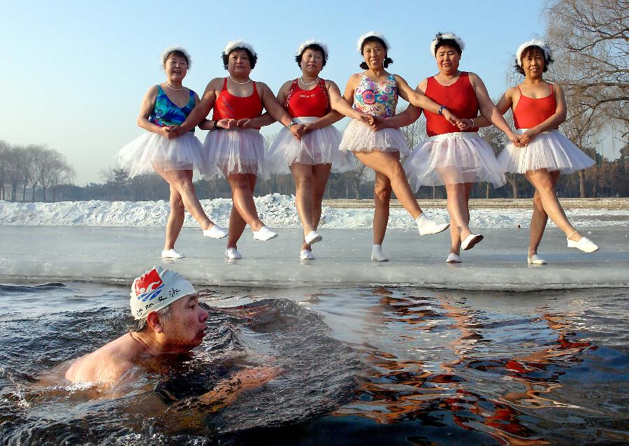 File photo taken on Feb. 5, 2010 shows six old ladies posing like ballerinas on a frozen water surface of Beiling Park, Shenyang, capital of northeast China's Liaoning Province. China had 190 million people at or above the age of 60 at the end of last year, according to the China National Committee on Ageing (CNCA). It is estimated that the figure will top 200 million next year and by 2050, one third of the Chinese population will be aged over 60. China is the only country in the world which has more than 100 million people aged 60 or above. (Xinhua/Wang Song)