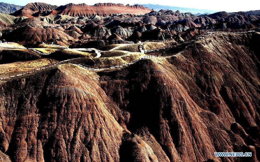 Photo taken on Oct. 24, 2012 shows a scenic view of the Danxia Landform in Zhangye City, northwest China's Gansu Province. Danxia is a special landform from reddish sandstone that has been eroded over time into a series of mountains surrounded by curvaceous cliffs and many unusual rock formations. (Xinhua/Wang Jiang)