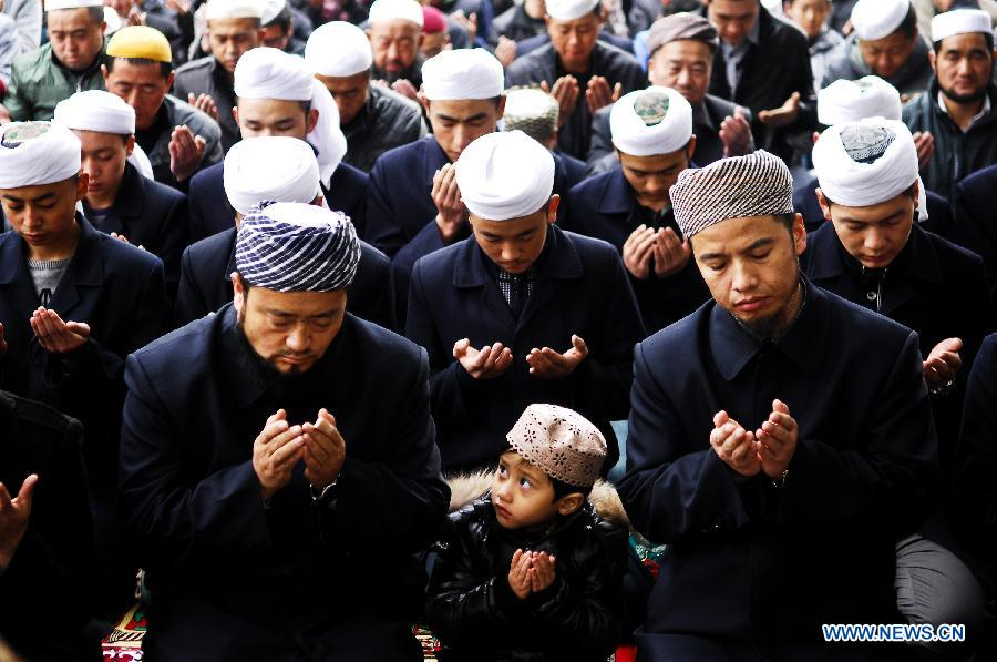 Muslims pray in a mosque in Xining City, capital of northwest China's Qinghai Province, Oct. 25, 2012. Chinese Muslims on Thursday celebrated the annual Corban Festival, which is a major Islamic festival showing faith and obedience to Allah. (Xinhua/Wu Gang)