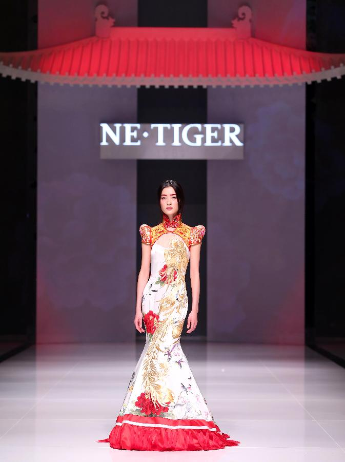 A model presents a creation in the NE · TIGER Collection show during the 2012 China International Fashion Week in Beijing, capital of China, Oct. 25, 2012. (Xinhua/Chen Jianli)