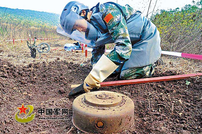 "The picture shows Cui Yongbiao, a mine clearer of the 10th Chinese peacekeeping engineer battalion to Lebanon, is removing an anti-tank mine. The ""Blue Line"" minefield along the border between Lebanon and Israel, known as a ""miniature landmine museum"", is one of the areas that have the most types and quantities of landmines and have the greatest difficulty in mine clearance. The Chinese engineer battalion has cleared a total of 10,000-odd landmines and unexploded bombs since 2006. (Photo by Li Qiang)"