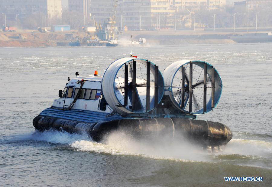 A hovercraft travels over the Heihe section of the Heilongjiang River, a border river between China and Russia, in northeast China's Heilongjiang Province, Oct. 26, 2012. China and Russia on Friday started the hovercraft transportation over the Heihe section of the Heilongjiang River, and a total of 16 hovercrafts were put into service this year. (Xinhua/Qiu Qilong)