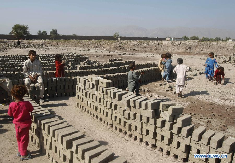 Afghan children work at a brick factory on the outskirt of Nangarhar province of eastern Afghanistan on Oct. 29, 2012. The child labor has remained rampant in brick kiln industry of the country. Some 56 percent of brick makers in Afghanistan are children under the age of 18, according to a survey report released by UN International Labour Organization (ILO) in February.(Xinhua/Tahir Safi)