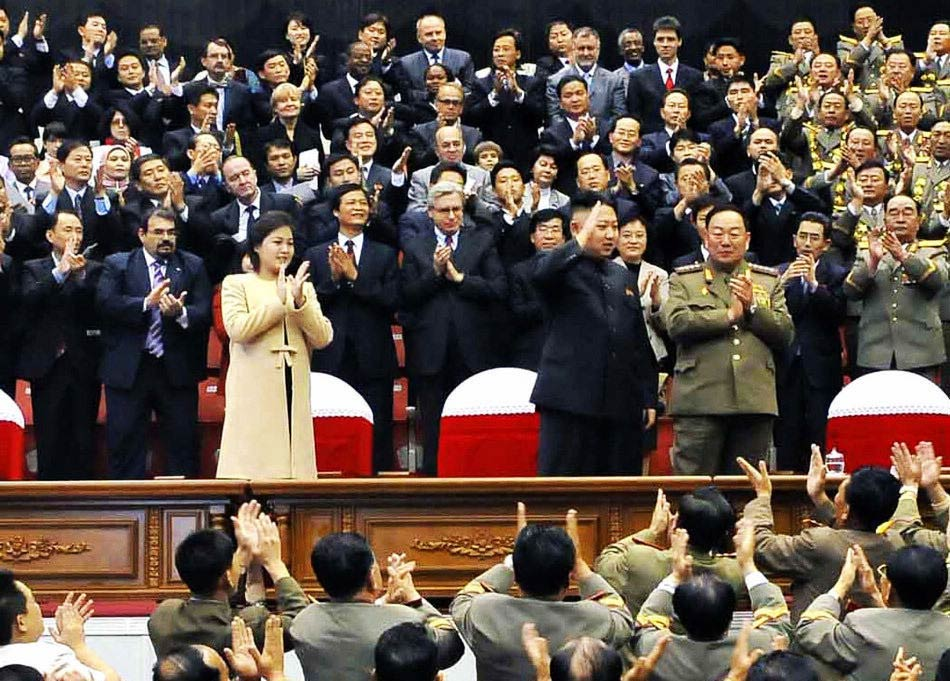 North Korea's top leader Kim Jong Un and his wife Ri Sol Ju appear at the auditorium on Oct. 29, 2012. The Moranbong Band gave a performance on Monday to mark the 60th anniversary of Kim Il Sung Military University, the highest seat of Juche-oriented military education, according to the country's official news agency KCNA's report on Oct. 30, 2012. (Xinhua/KCNA)