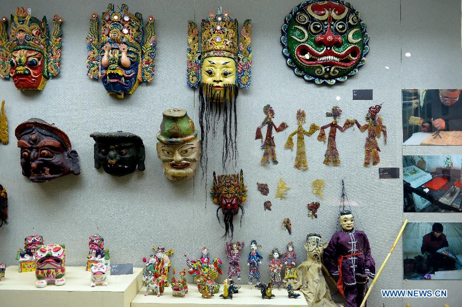 Photo taken on Nov. 7, 2012 shows puppets and masks of Nuo opera, one of the most popular folk operas in southwest China, displayed at the folk arts museum of Shandong University of Art & Design in Jinan, capital of east China's Shandong Province. (Xinhua/Guo Xulei)