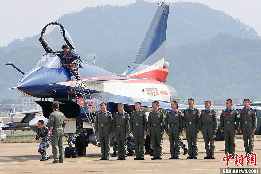 Eight J-10 jet fighters of PLA Air Force' August 1st Aerobatic Team arrive at Zhuhai in  Guangdong province on Nov. 5, 2012. One of the jets will be exhibited on the ground and the  other seven will give aerobatic performances during the 9th China International Aviation &  Aerospace Exhibition to be held in Zhuhai from Nov.13 to 18. (Chinanews.com/ Lu Haifeng)