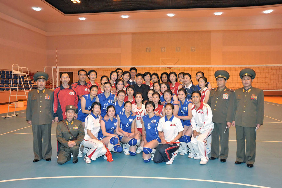 Kim Jong Un, top leader of the Democratic People's Republic of Korea (DPRK) and his wife Ri Sol Ju poses with members of women's volleyball, according to the country's official news agency KCNA's report on Nov.7, 2012. (KCNA)