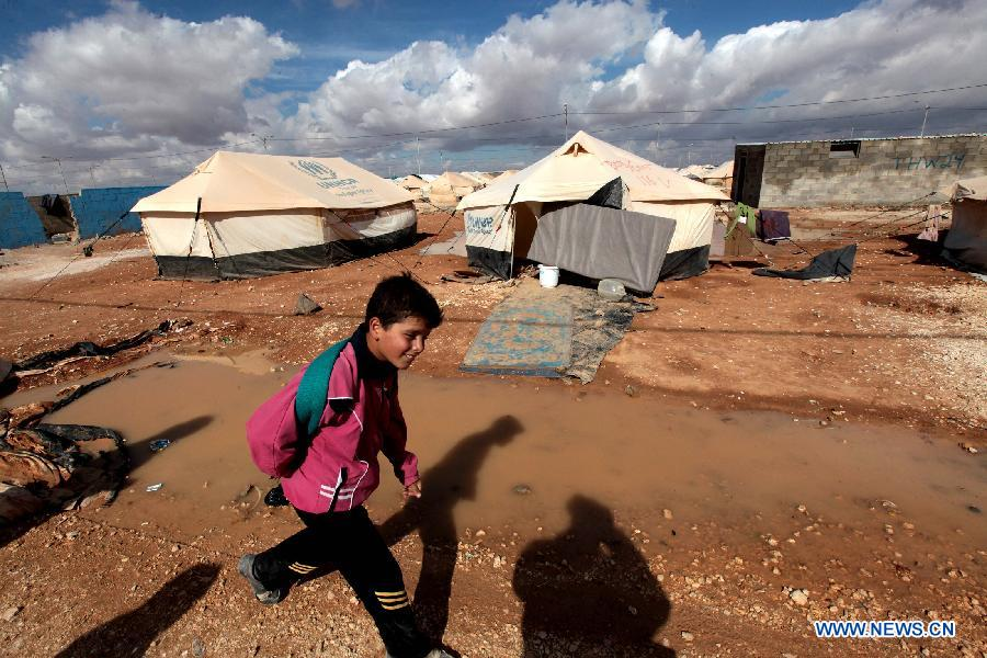 A Syrian refugee boy walks at Al Zaatri Syrian refugee camp in the Jordanian city of Mafraq, near the border with Syria, on Nov. 12, 2012. (Xinhua/Mohammad Abu Ghosh)