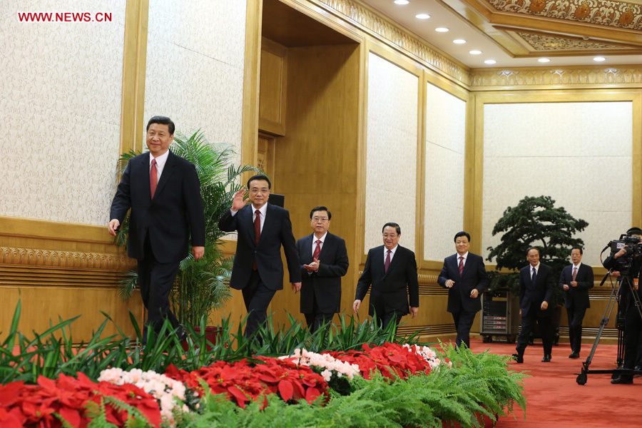 Xi Jinping, Li Keqiang, Zhang Dejiang, Yu Zhengsheng, Liu Yunshan, Wang Qishan, Zhang Gaoli, who have been elected members of the Standing Committee of the Political Bureau of the 18th Central Committee of the Communist Party of China (CPC), arrive to meet with Chinese and foreign journalists at the Great Hall of the People in Beijing, capital of China, Nov. 15, 2012. (Xinhua/Ding Lin )