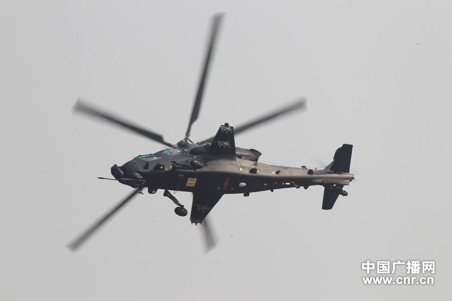 "A WZ-10 attack helicopter practices on the first day of Airshow China 2012, which kicked off in south China's Zhuhai on Nov. 13, 2012, after its first public appearance on Nov. 11, 2012. WZ-10, nicknamed China's ""Apache"", is the most advanced attack helicopter of the PLA and also the most expected Chinese aircraft at the Airshow China 2012. (CNR/Xu Ao)"