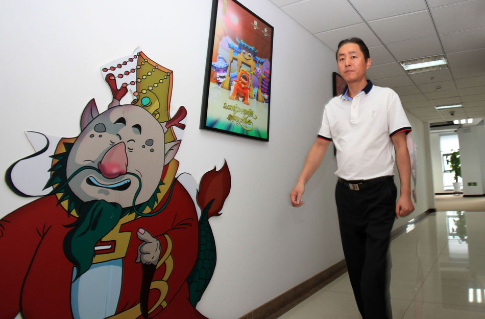 Wang Jin walks past an anime poster in the Program Production Center of China ACG Group Co., Ltd in Beijing, capital of China, April 19, 2012. (Xinhua/Meng Chenguang)