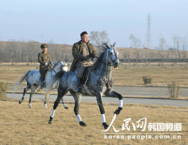 DPRK's top leader Kim Jong Un inspects the training ground of horse riding company of KPA on Nov. 19, 2012. (Photo/ People's Daily Online)