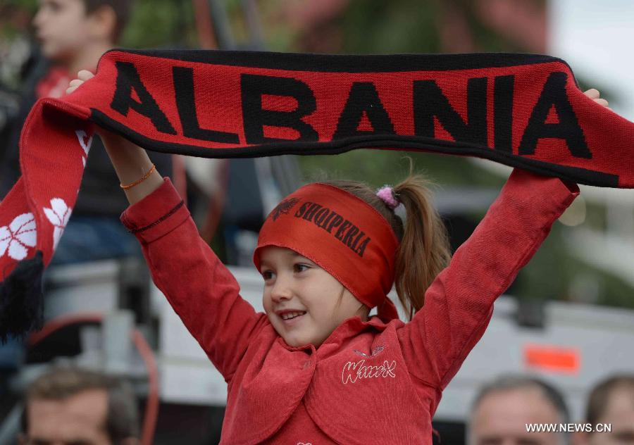 Albanian people take part in the celebration marking the country's 100th anniversary of independence, in Tirana, Albania, Nov. 28, 2012. (Xinhua/Liu Lihang)