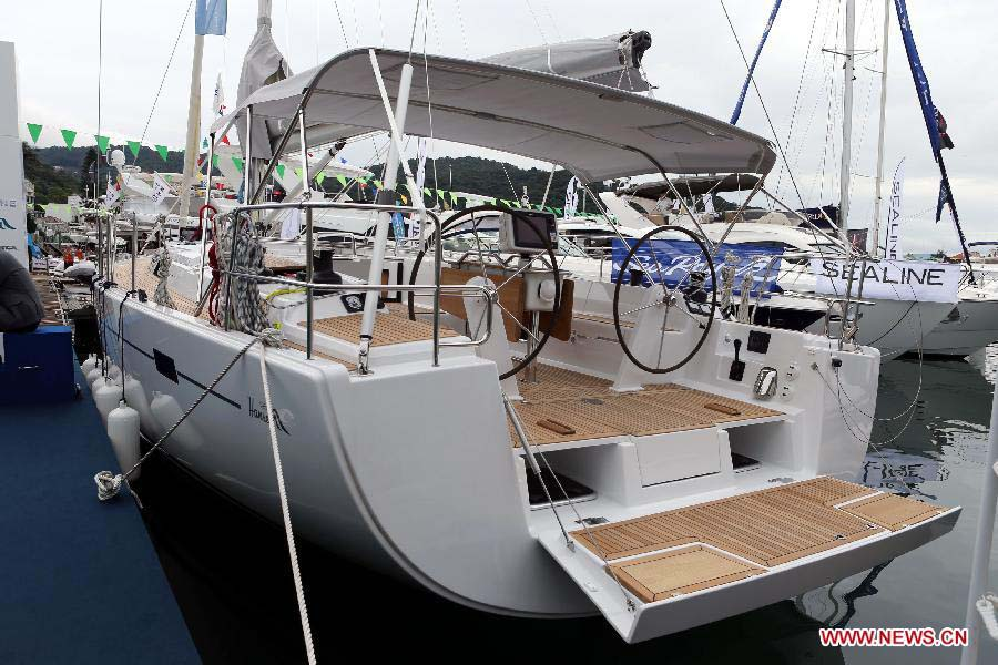 A yacht is pictured at its booth during Hong Kong International Boat Show 2012 in south China's Hong Kong, Dec. 2, 2012. The boat show closed on Sunday. (Xinhua/Li Peng)