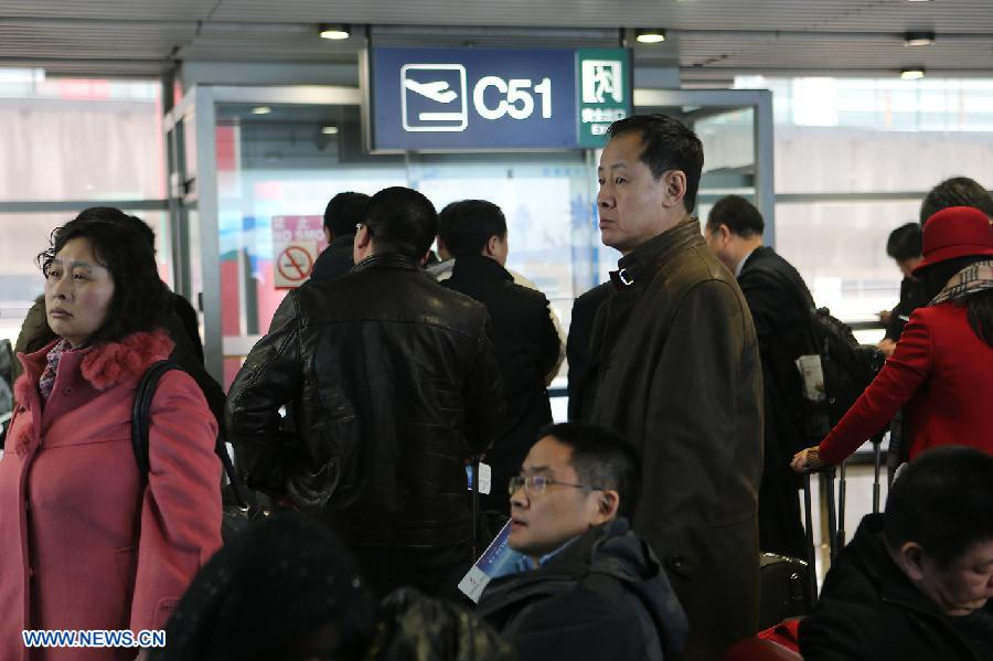 Passengers wait for flights at Beijing Capital International Airport in Beijing, capital of China, Dec. 12, 2012. A snow that hit China's capital city on Wednesday has led to massive flight delays at Beijing Capital International Airport. (Xinhua/Wan Xiang)
