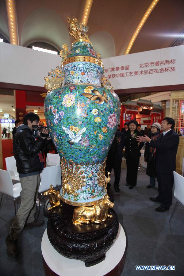 A cloisonne vase is displayed at the Beijing pavilion during the 2012 China Time-Honoured Brand Expo in Beijing, capital of China, Dec. 12, 2012. The five-day expo, opening Wednesday at the Beijing Exhibition Center, attracted some 160 Chinese time-honoured brand exhibitors. (Xinhua)