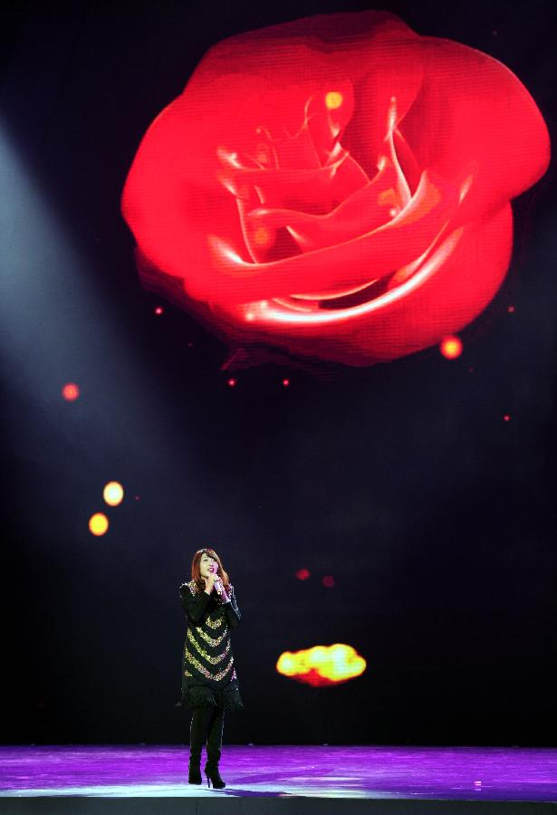 A singers performs at the opening ceremony of the 7th China Beijing International Cultural & Creative Industry Expo in Beijing, capital of China, Dec. 19, 2012. The five-day expo opened Wednesday night in Beijing. (Xinhua/Luo Xiaoguang)