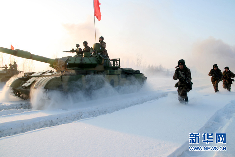 An armored regiment under the Shenyang Military Area Command of the Chinese People's Liberation Army (PLA) took its troops to unfamiliar area on December 16, 2012 to conduct drill on such subjects as rapid maneuvering and coordination of infantrymen and tanks, in a bid to temper its troops in an all-round way. (Xinhua/Xu Zhilin)