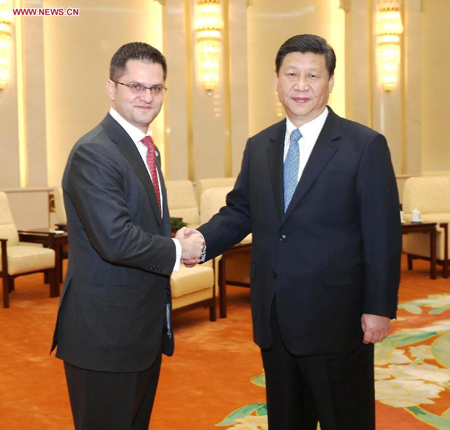 Xi Jinping (R), general secretary of the Communist Party of China (CPC) Central Committee, shakes hands with Vuk Jeremic, president of the 67th Session of the UN General Assembly, in Beijing, capital of China, Dec. 27, 2012. (Xinhua/Liu Weibing)