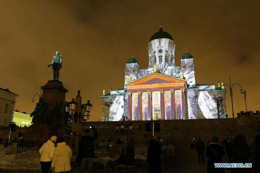 A cathedral is illuminated on the senate square in Helsinki, capital of Finland, on Jan. 6, 2013. Epiphany is celebrated here with an art slide show. (Xinhua/Li Jizhi)