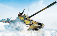 Armored regiment in drill on snow-capped plateau