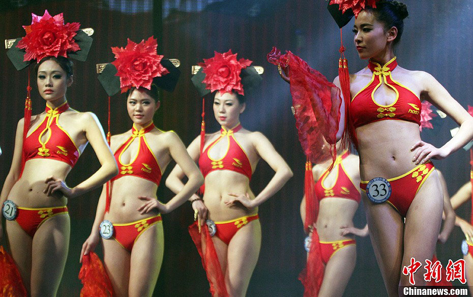 842346984db Contestants wearing Chinese style bikinis perform at the China final of the 37th  Miss Bikini International Competition in Zhaoqing, south China's Guangdong  ...
