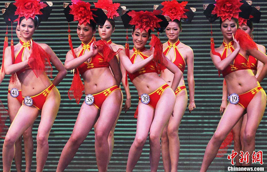 Contestants wearing Chinese style bikinis perform at the China final of the 37th Miss Bikini International Competition in Zhaoqing, south China's Guangdong Province, Jan. 12, 2013. Nearly 30 girls took part in the China final on Saturday. (CNSPHOTO/Qian Xingqiang)