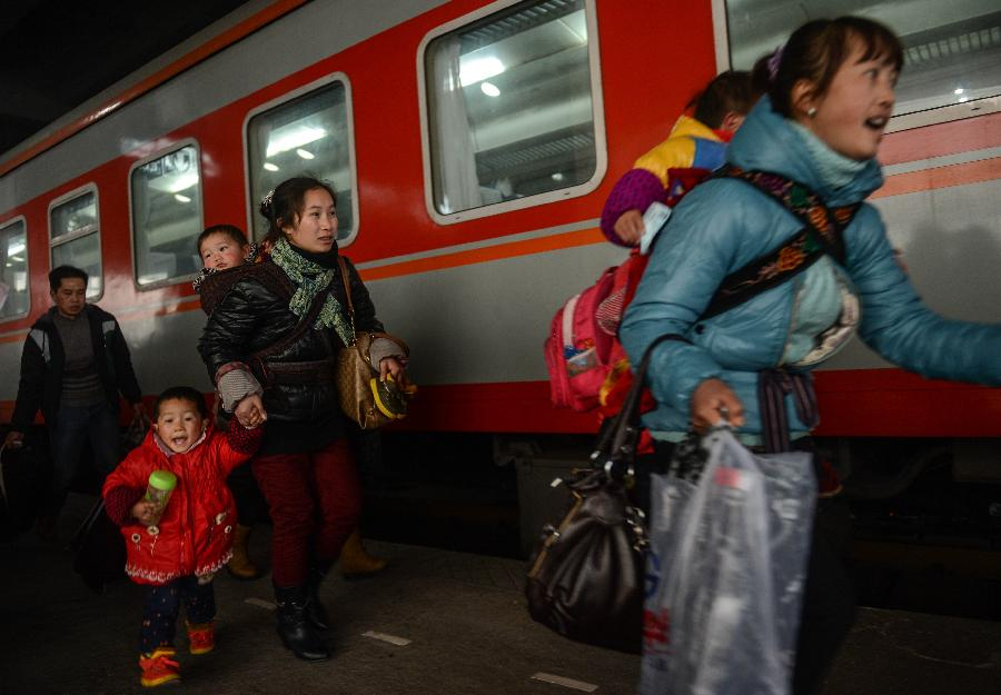 Some children and their family members get ready to board a train from Hangzhou to Guiyang, capital of southwest China's Guizhou Province, in Hangzhou, capital of east China's Zhejiang Province, Jan. 22, 2013. Many migrant workers and their children have started to return home in order to avoid the Spring Festival travel peak that begins on Jan. 26 and will last for about 40 days. The Spring Festival, the most important occasion for a family reunion for the Chinese people, falls on the first day of the first month of the traditional Chinese lunar calendar, or Feb. 10 this year. (Xinhua/Han Chuanhao)