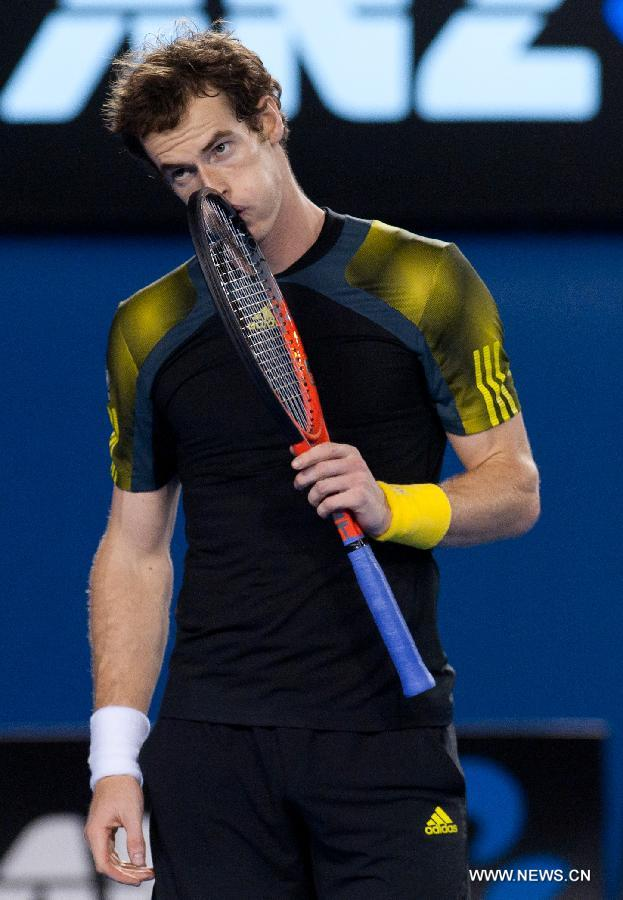 Andy Murray of Britain reacts during the men's singles semifinal match against Roger Federer of Switzerland at the 2013 Australian Open tennis tournament in Melbourne, Australia, Jan. 25, 2013. Murray won 3-2 to enter the final. (Xinhua/Bai Xue)