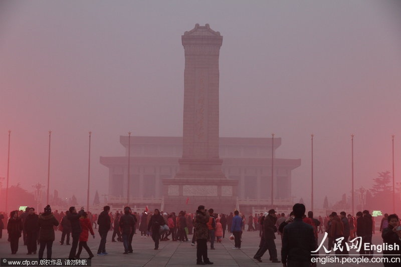 A photo taken on Jan. 28 shows the fog shrouded Tiananmen Square. Beijing's meteorological center on Monday issued a yellow-coded alert for haze as the fourth foggy weather in this month hit the city and cuts the visibility below 3,000 meters in major parts of Beijing. (Photo/CFP)