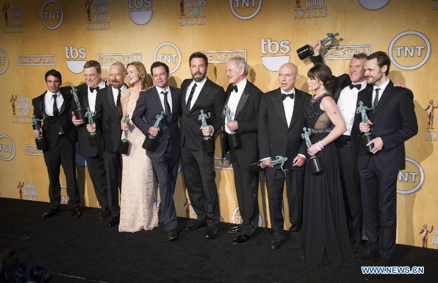 "The casts of ""Argo"" hold their trophies after receiving the award for outstanding performance by a cast in a motion picture for the film ""Argo"" at the 19th annual Screen Actors Guild Awards in Los Angeles, California January 27, 2013. (Xinhua/Yang Lei)"