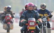 Migrant workers return home on motorcycle