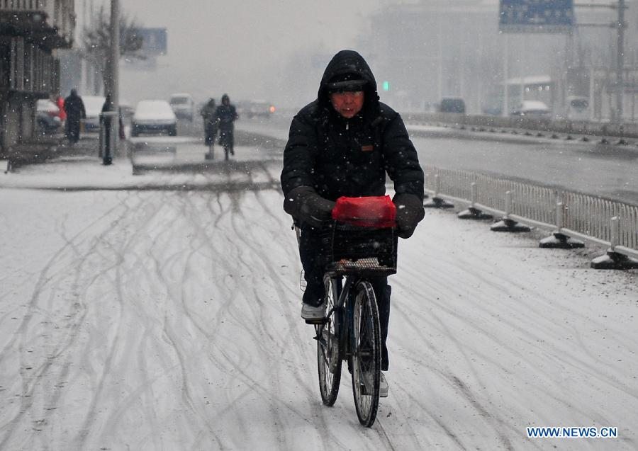 Cold snap brings snow to most parts of China