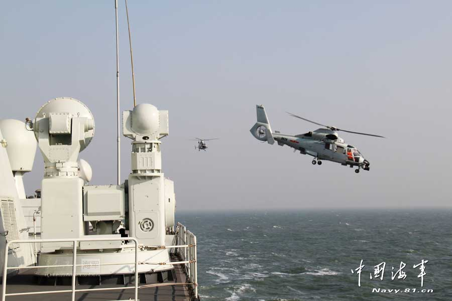 A ship-borne aircraft troop unit of the aviation force under the North China Sea Fleet of the Navy of the Chinese People's Liberation Army (PLA) successfully completed high-intensity landing training for twelve uninterrupted hours recently for the first time and greatly enhanced troop unit's capabilities of ship-helicopter coordination as well as diversified-task performing under complicated weather conditions. (China Military Online/Hu Baoliang)