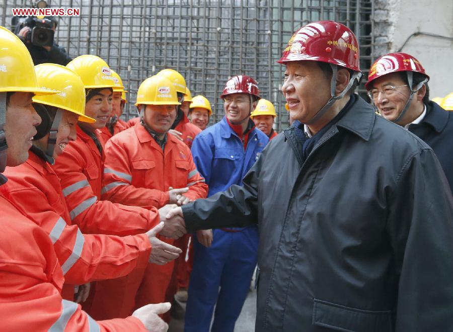 Xi Jinping (R Front), general secretary of the Communist Party of China (CPC) Central Committee and chairman of the CPCP Central Military Commission, meets with workers at the construction site of the Nanluoguxiang station of subway line 8 in Beijing, capital of China, Feb. 8, 2013. Xi Jinping on Friday visited and extended greetings to laborers including subway construction workers, sanitation workers, police officers and taxi drivers in Beijing, ahead of the Chinese traditional Spring Festival, which starts on Feb. 10 this year. (Xinhua/Ju Peng)