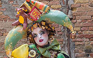 Costumed revellers gather in Venice