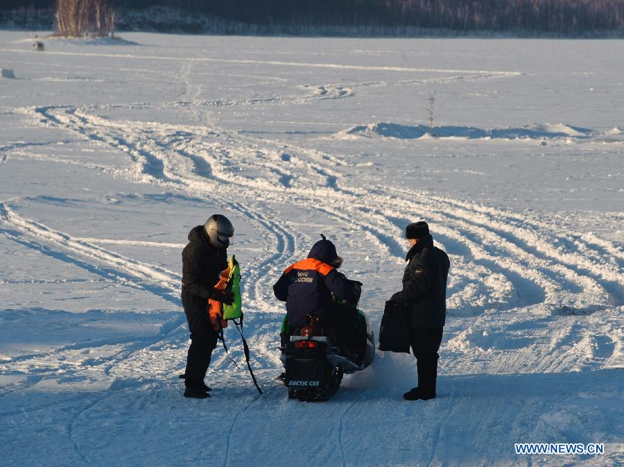 A member of Russian ministry of emergency situations (C) rides a snow motorbike to the site of the meteorite fall at the chebarkul lake near Chelyabinsk, about 1500 kilometers east of Moscow, Russia, Feb. 16, 2013. A meteorite burst into the sky over Russia's Urals region on Friday. Emergency Situations Minister Vladimir Puchkov said there was no proof that meteoritic fragments have been found. (Xinhua/Jiang Kehong)