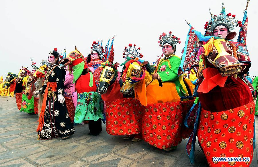 File photo taken on March 18, 2010 shows members of a Shehuo performance team preparing for shows at a temple fair in Huaiyang, central China's Henan Province. (Xinhua/Wang Song)