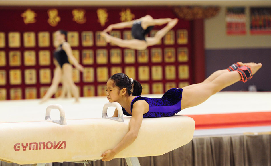 A girl of China's national gymnastics team is in training, Beijing, Feb. 12, 2013. Members of China's national gymnastics team kept practicing even during the Spring Festival holiday. (Xinhua/Tao Xiyi)