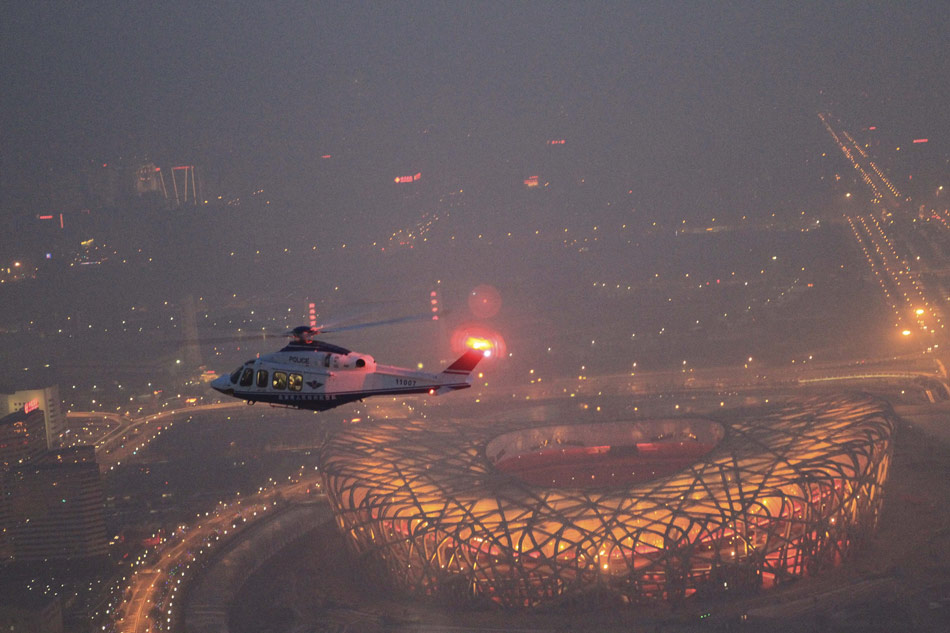 A police helicopter patrols over Beijing on Feb. 9, 2013. Beijing police dispatched five helicopters to ensure the capital's security on the eve of the Lunar New Year. (Xinhua/Zhang Yan)
